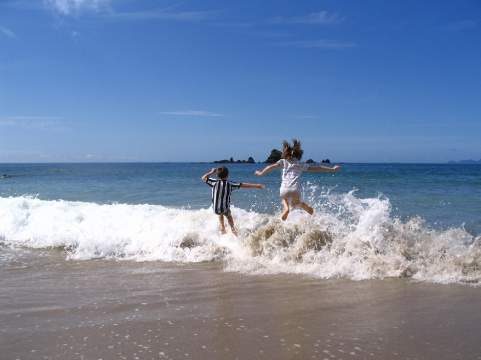 Children splashing in waves